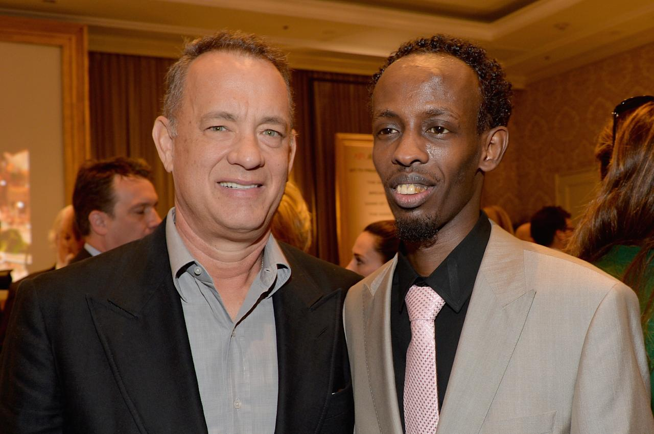 BEVERLY HILLS, CA - JANUARY 10: (L-R) Actors Tom Hanks and Barkhad Abdi attend the 14th annual AFI Awards Luncheon at the Four Seasons Hotel Beverly Hills on January 10, 2014 in Beverly Hills, California. (Photo by Alberto E. Rodriguez/Getty Images for AFI)