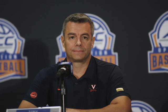 Virginia coach Tony Bennett answers a question during the Atlantic Coast Conference NCAA college basketball media day in Charlotte, N.C., Tuesday, Oct. 8, 2019. (AP Photo/Nell Redmond)