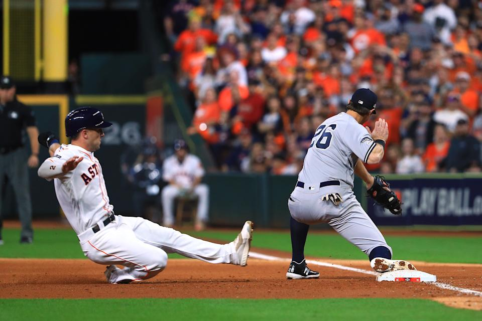 New York's DJ LeMahieu (26) completes the double play on Houston's Alex Bregman during Game 1 of the ALCS on Saturday. (Getty)