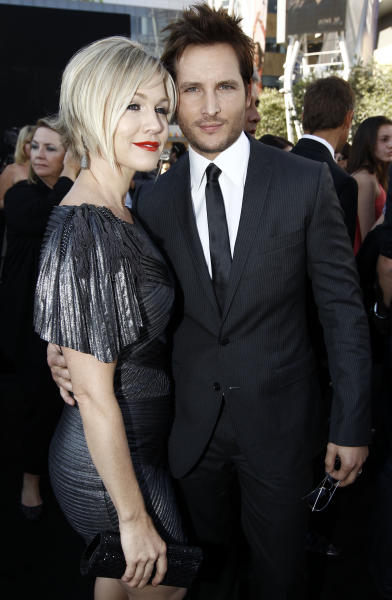 """FILE - In this June 24, 2010 file photo, actress Jennie Garth, left, and her husband actor Peter Facinelli arrive at the premiere of """"The Twilight Saga: Eclipse"""" in Los Angeles. In a joint statement, the couple said they've decided to end their marriage. They have been married for 11 years and are parents to three daughters. (AP Photo/Matt Sayles, file)"""