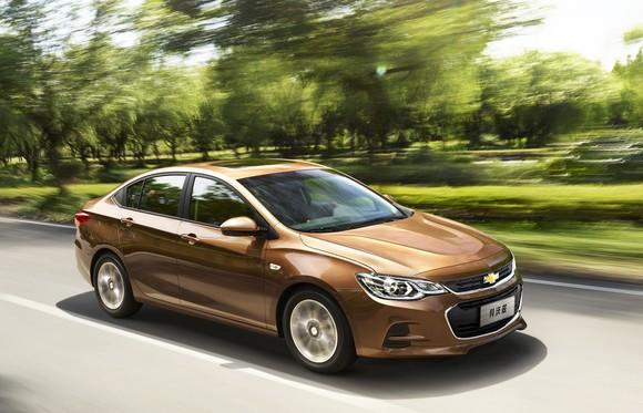 A brown Chevrolet Cavalier, a compact sedan sold in China.