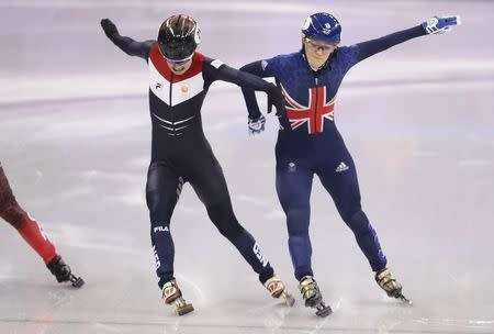 Short Track Speed Skating Events – Pyeongchang 2018 Winter Olympics – Women's 500m Semifinal – Gangneung Ice Arena - Gangneung, South Korea – February 13, 2018 - Yara van Kerkhof of the Netherlands and Elise Christie of Britain compete. REUTERS/Lucy Nicholson