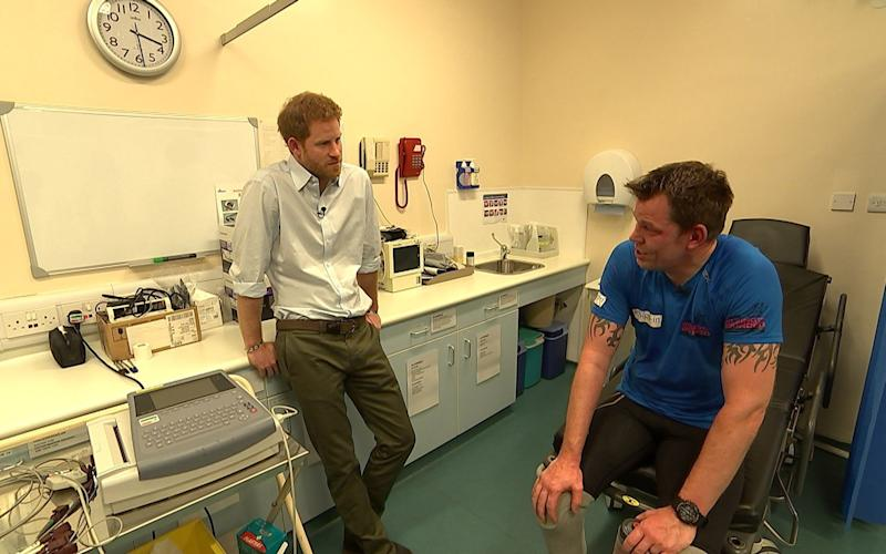 Prince Harry (left) with double amputee Duncan Slater who is preparing to run the Marathon des Sables later this month - Credit: ITV News/PA