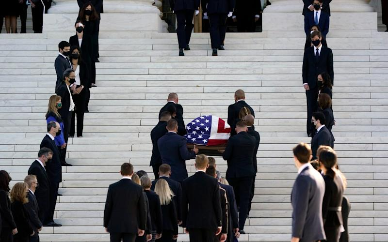 The flag-draped casket of Justice Ruth Bader Ginsburg arrives at the Supreme Court in Washington on Wednesday - AP Photo/J. Scott Applewhite