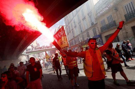 A French CGT labour union employee holds flares during a demonstration in Marseille as part of nationwide protests against plans to reform French labour laws, France, June 14, 2016. REUTERS/Yves Herman