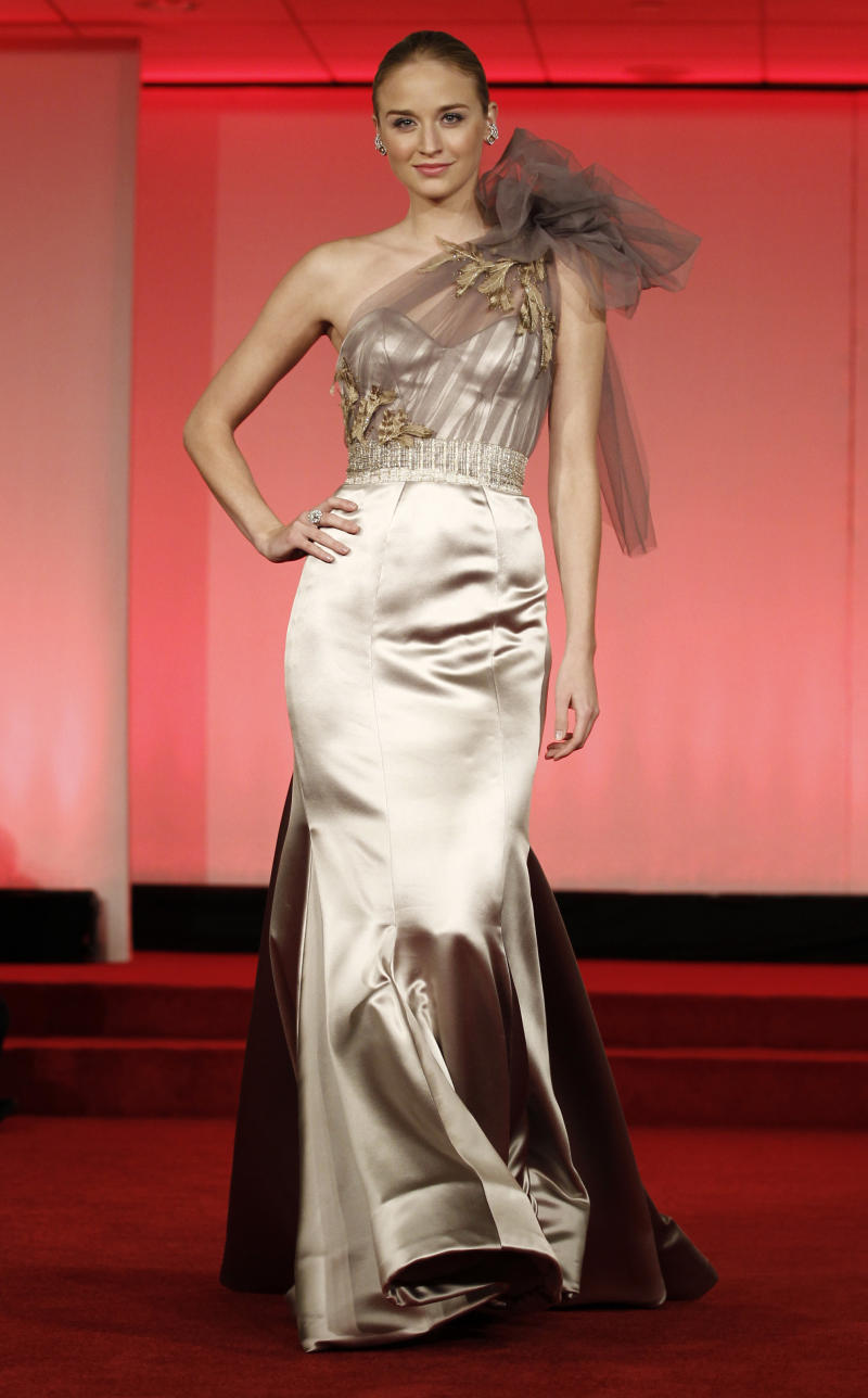 A model wearing a dress by designer Katelyn Bischof walks the runway during the 83rd Academy Awards Oscars Designer Challenge fashion show at the Academy of Motion Picture Arts and Sciences in Beverly Hills, Calif., Tuesday, Feb. 15, 2011. (AP Photo/Matt Sayles)