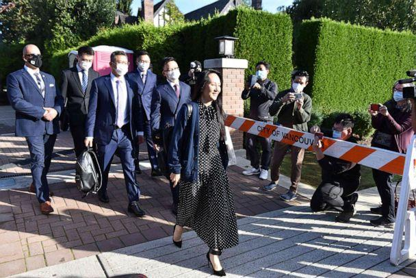 PHOTO: Huawei Chief Financial officer Meng Wanzhou leaves her Vancouver home to attend her extradition hearing, Sept. 24, 2021, in Vancouver, Canada. (Don Mackinnon/AFP via Getty Images)
