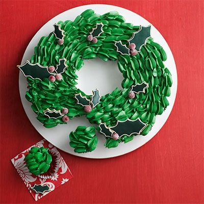 """<p>With sugared cranberries and cutout-cookie leaves, this cupcake wreath looks pretty enough to hang on your door, but we suggest eating these instead.</p><p><em><a href=""""https://www.goodhousekeeping.com/food-recipes/a15485/cupcake-wreath-recipe-wdy1213/"""" target=""""_blank"""">Get the recipe »</a></em></p>"""