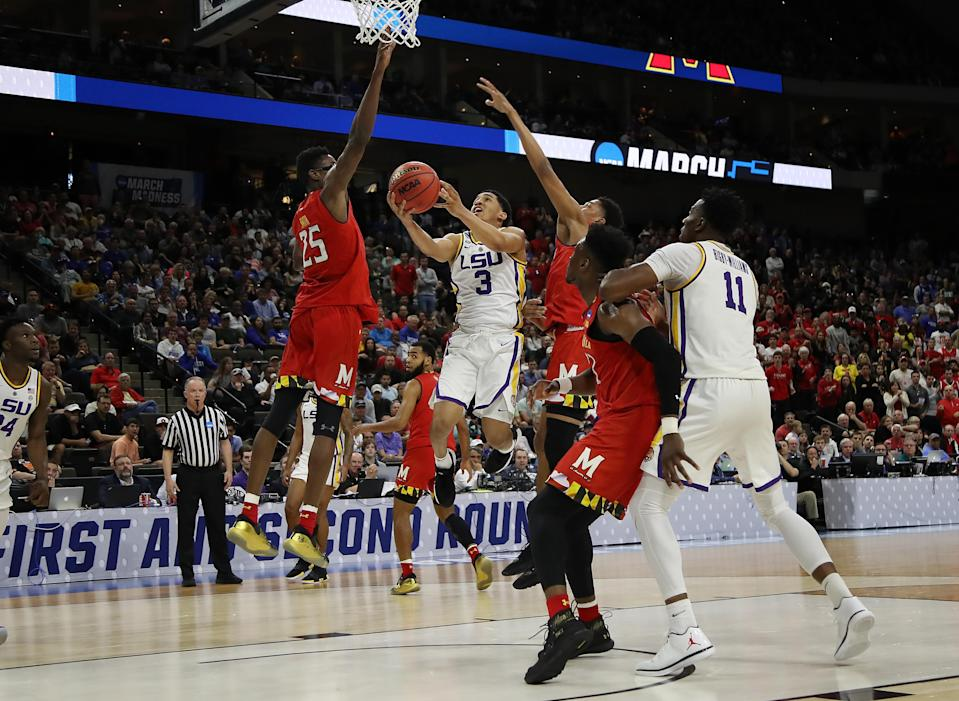 <p>Tremont Waters #3 of the LSU Tigers goes up for a shot against Jalen Smith #25 of the Maryland Terrapins during the second half of the game in the second round of the 2019 NCAA Men's Basketball Tournament at Vystar Memorial Arena on March 23, 2019 in Jacksonville, Florida. (Photo by Sam Greenwood/Getty Images) </p>