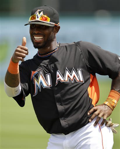 Miami Marlins shortstop Jose Reyes gives a thumbs up as he warms up before a spring training baseball game against the Washington Nationals in Jupiter, Fla., Tuesday, March 27, 2012. (AP Photo/Patrick Semansky)