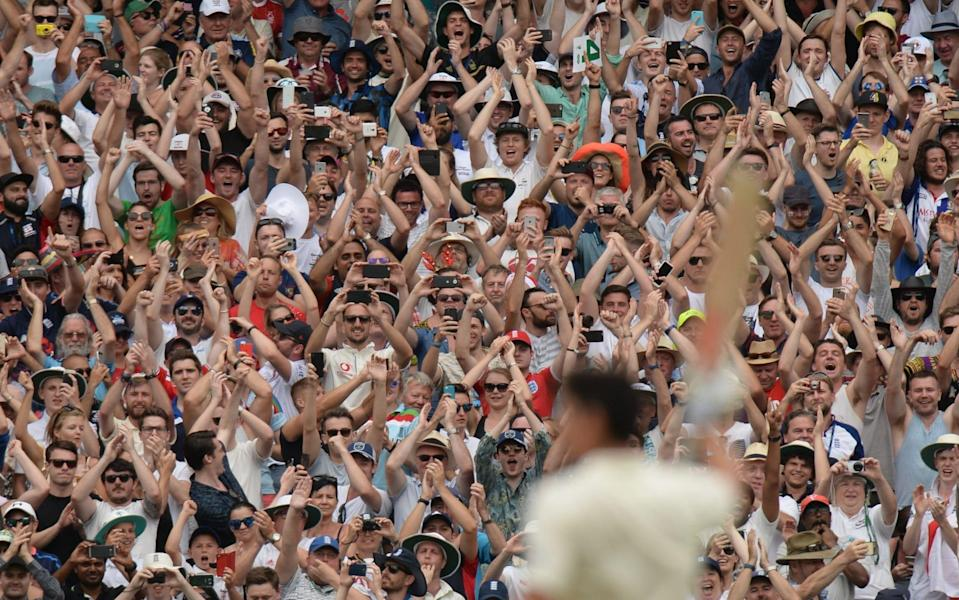 England fans clap after Alastair Cook reached two hundred during the third day of the fourth Ashes cricket test match between Australia and England at the Melbourne Cricket Ground on December 28, 2017 in Melbourne, Australia - Philip Brown/Getty Images