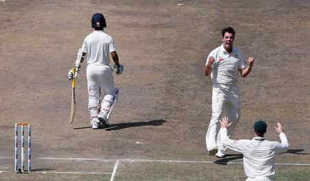 Cricket - India v Australia - Third Test cricket match - Jharkhand State Cricket Association Stadium, Ranchi, India - 18/03/17 - Australia's Pat Cummins celebrates after dismissing India's Ajinkya Rahane. REUTERS/Adnan Abidi