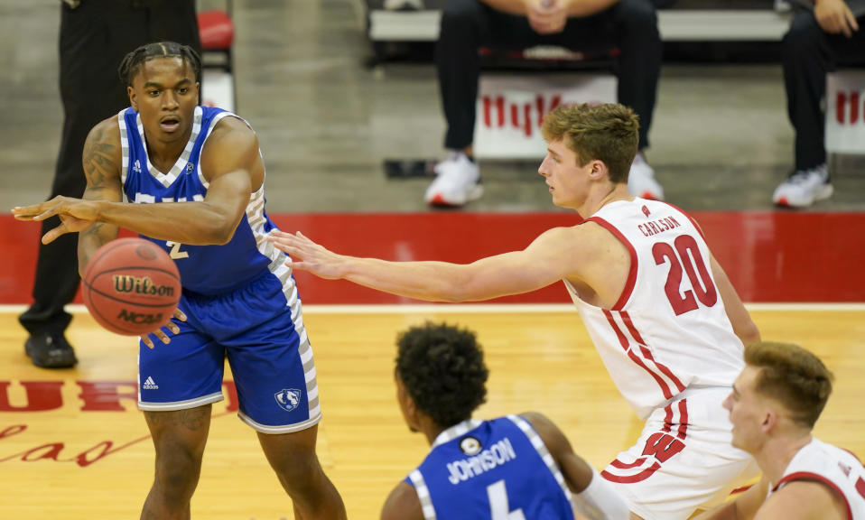 Eastern Illinois' Jordan Skipper-Brown (2) passes the ball past Wisconsin's Ben Carlson (20) during the first half of an NCAA college basketball game Wednesday, Nov. 25, 2020, in Madison, Wis. (AP Photo/Andy Manis)