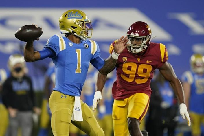 UCLA quarterback Dorian Thompson-Robinson (1) is threatened by Southern California linebacker Drake Jackson (99) during an NCAA football game Saturday, Dec 12, 2020, in Pasadena, Calif. (AP Photo/Ashley Landis)