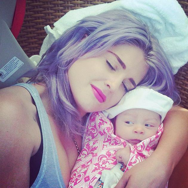 """Celebrity photos: It's no secret that Kelly Osbourne is absolutely besotted with her niece, Jack Osbourne's daughter, Pearl. The star tweeted this adorable photo of her giving Pearl a cuddle, along with the caption: """"I have never loved a baby more! Pearl is my family's miracle!"""" Too cute! Copyright [Kelly Osbourne]"""