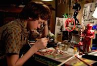 <p>In <i>Super 8</i>, Abrams's homage to Spielberg's '80s oeuvre, the original Kenner R2-D2 action figure earns screen time tucked among the models. <i>(Credit: Paramount Pictures)</i><br></p>