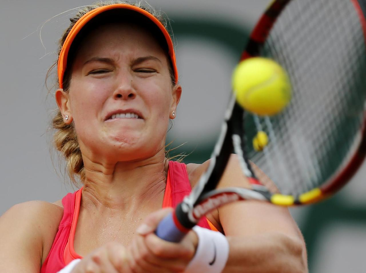 Canada's Eugenie Bouchard returns the ball to Spain's Carla Suarez Navarro during their quarterfinal match of the French Open tennis tournament at the Roland Garros stadium, in Paris, France, Tuesday, June 3, 2014. Bouchard won 7-6, 2-6, 7-5. (AP Photo/David Vincent)