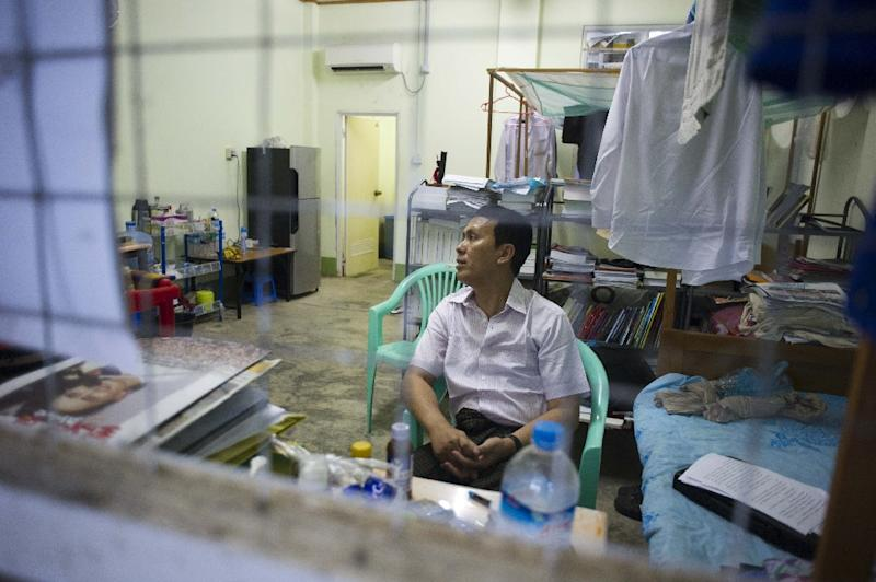 Phyo Min Thein, a Lower House MP with the National League for Democracy, sits in the government lodgings provided for him and his family in Naypyidaw on August 24, 2015 (AFP Photo/Ye Aung Thu)