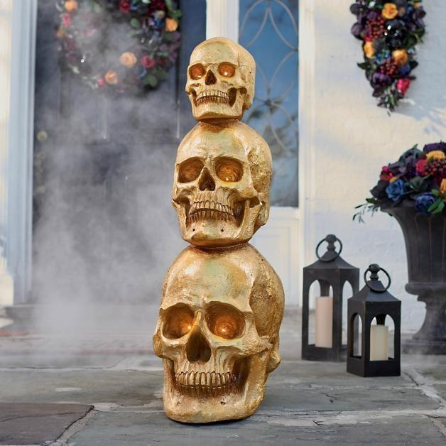 <p>The <span>Gold Stacked Skull Topiary</span> ($249) will stare at you right in the eyes. </p>