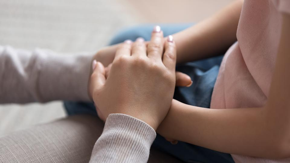 Mom giving support trust to little daughter holding hands help child keep safe, adult parent mother and kid love, children charity adoption protection, foster care, family kindness, close up view