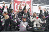 Alex Bowman celebrates the win with his teammates following a NASCAR Cup Series auto race at Dover International Speedway, Sunday, May 16, 2021, in Dover, Del. Alex Bowman wins the race. (AP Photo/Chris Szagola)