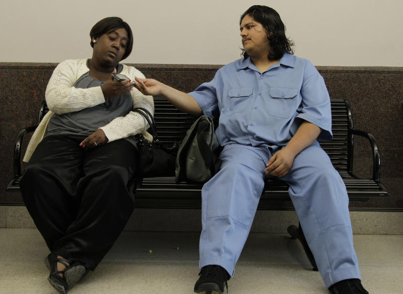 Auboni Champion Morin and Fernando Morin wait outside a juvenile courtroom Thursday, March 15, 2012, in Houston. Their son, Miguel Morin vanished eight years ago with his babysitter, has been found safe. The former babysitter, 26-year-old Krystle Rochelle Tanner, was arrested Monday on a kidnapping charge. She was being held in jail in San Augustine, a community about 140 miles northeast of Houston. (AP Photo/Pat Sullivan)