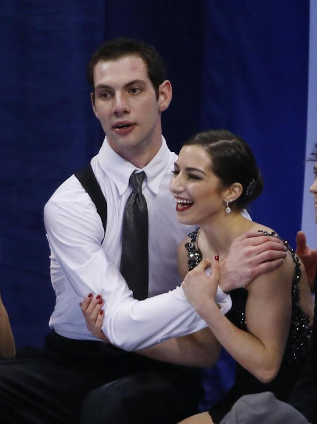 Marissa Castelli and Simon Shnapir react as scores are posted after skating in the pairs free skate at the U.S. Figure Skating Championships in Boston, Saturday, Jan. 11, 2014. (AP Photo/Elise Amendola)