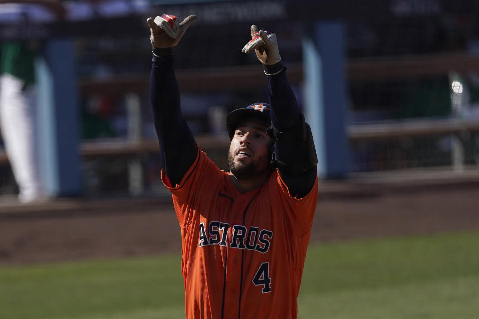 Houston Astros' George Springer celebrates after hitting a solo home run off of Oakland Athletics relief pitcher Yusmeiro Petit during the fifth inning of Game 2 of a baseball American League Division Series in Los Angeles, Tuesday, Oct. 6, 2020. (AP Photo/Ashley Landis)