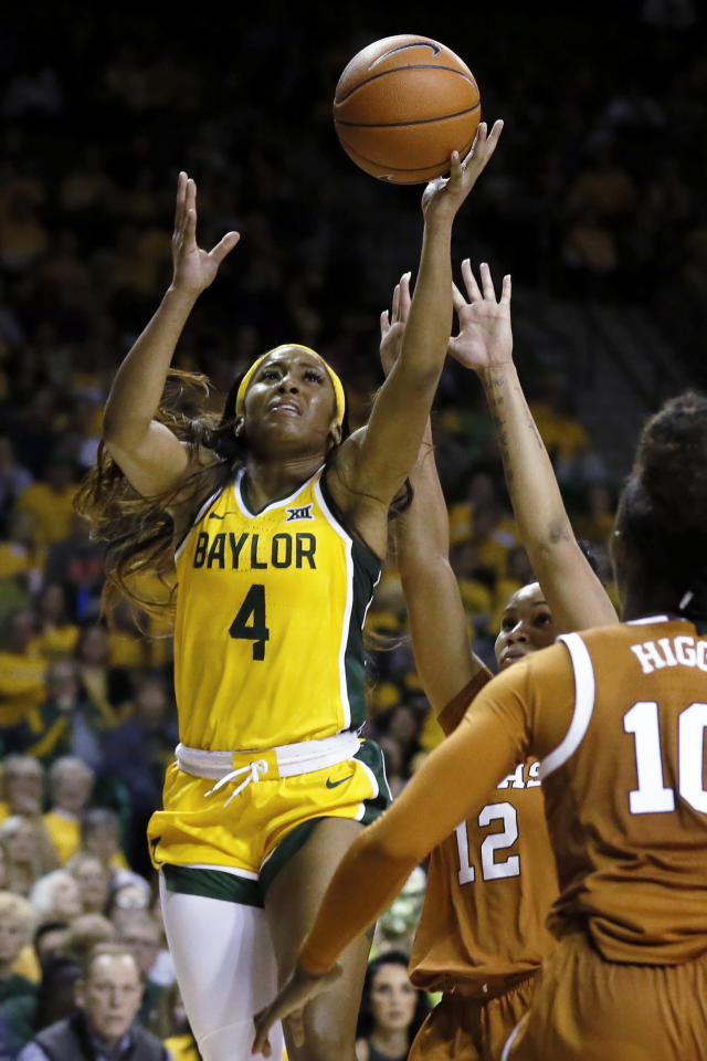 Baylor guard Te'a Cooper (4) shoots next to Texas guard Jada Underwood, back right, during the second half of an NCAA college basketball game Thursday, March 5, 2020, in Waco, Texas. Baylor won 69-53. (AP Photo/Ray Carlin)