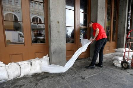 An employee places sandbags in front of a business in the French Quarter as Tropical Storm Barry approaches land in New Orleans