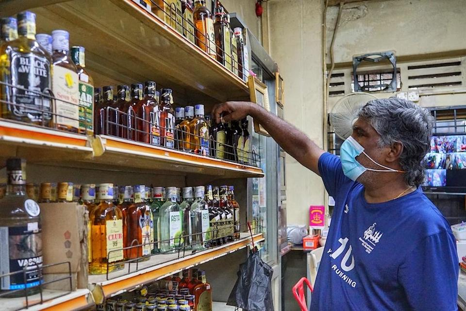 S. Rajan shows the liquor sold at his convenience shop in Kuala Lumpur November 19, 2020. — Picture by Ahmad Zamzahuri
