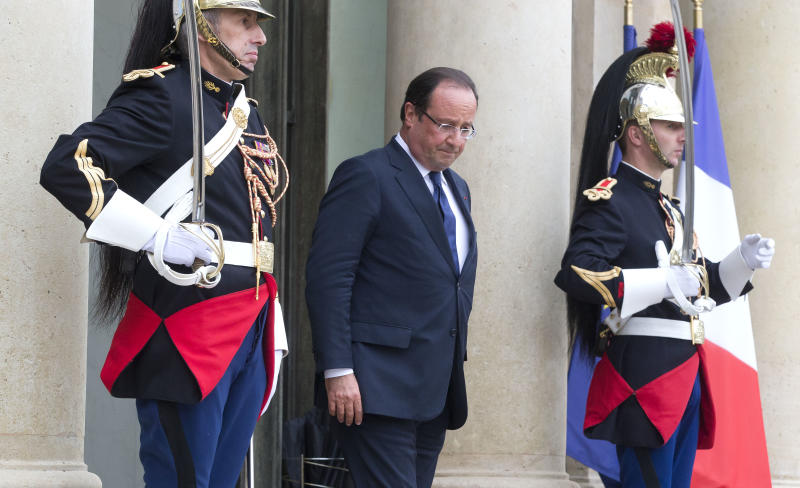 French President Francois Hollande, center, walks out of the lobby of the Elysee Palace as he waits for the arrival of Saudi Foreign Minister Prince Saud Al Faisal, Foreign Minister of the United Arab Emirates Abdallah bin Zayid Al Nuhayyan and Jordanian Foreign Minister Nasser Judeh for a meeting on Syria, Paris, Friday, Sept. 13, 2013. (AP Photo/Michel Euler)