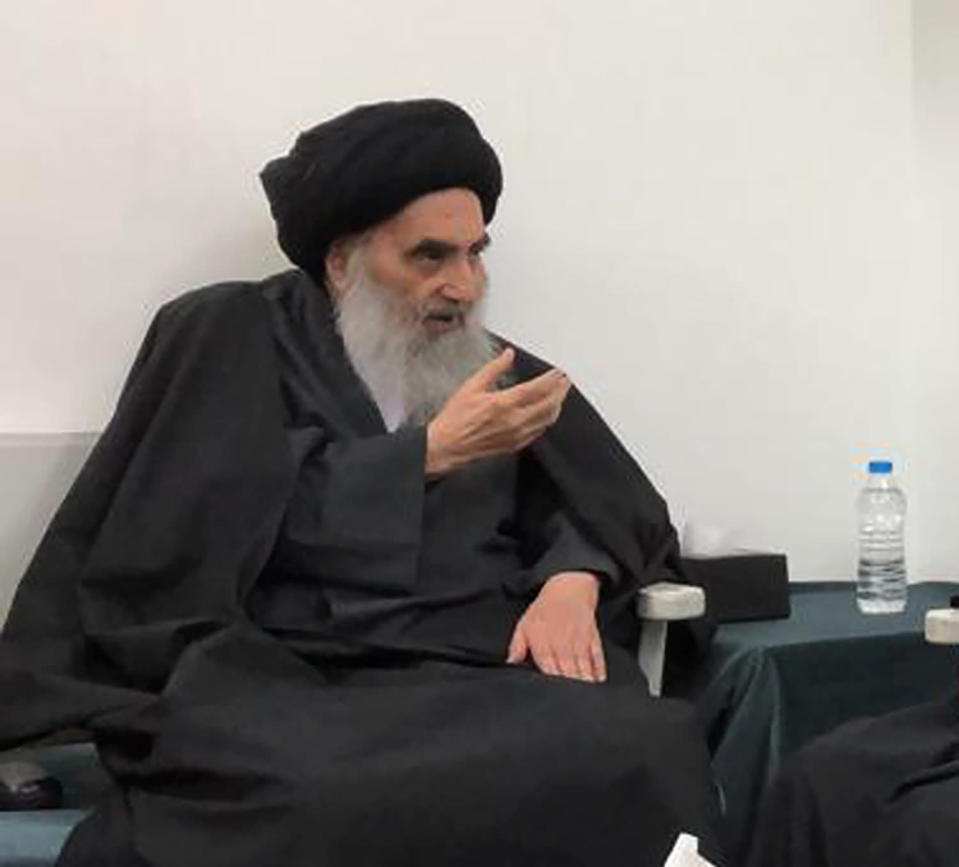 FILE - This handout photo from the office of Grand Ayatollah Ali al-Sistani shows senior Shiite cleric Grand Ayatollah Ali al-Sistani in the southern Iraqi city of Najaf on March, 13, 2019. Pope Francis is pushing ahead with the first papal trip to Iraq despite rising coronavirus infections, hoping to encourage the country's dwindling number of Christians who were violently persecuted during the Islamic State insurgency while seeking to boost ties with the Shiite Muslim world. (Office of Grand Ayatollah Ali al-Sistani, via AP)