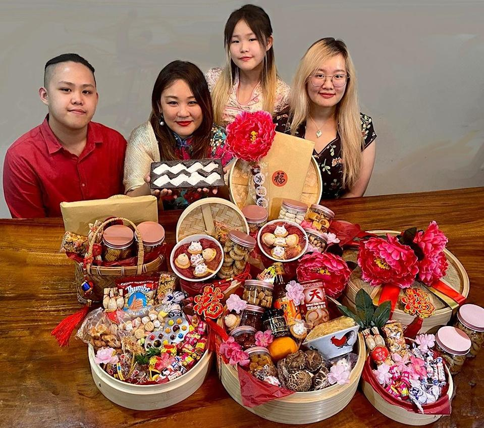 Former beauty pageant contestant Vanessa Yoong and her children — (from left) Jayden, Janelle (standing) and Joelle Yap — has come up with hampers that invoke nostalgic memories. — Photo courtesy of Vanessa Yoong