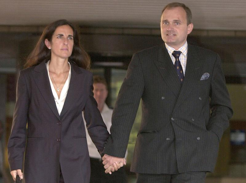 British Army Major Charles Ingram and his wife Diana leave the Southwark Crown Court in southeast London Wednesday, Aug. 28, 2002. The Ingrams appeared in court on deception and conspiracy charges along with co-defendant Tecwen Whittock, after they allegedly cheated while Major Ingram competed on the British TV game show 'Who Wants to be a Millionaire' in Sept. last year. (AP Photo/Richard Lewis)