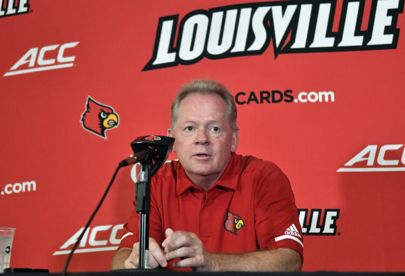 FILE - In this Aug. 11, 2018, file photo, then-University of Louisville head football coach Bobby Petrino speaks to reporters during Louisville Football Media Day, in Louisville, Ky. Petrino, a coach with a track record of on-the-field success but off-the-field embarrassments, will be the next coach at Missouri State, the university said Wednesday, Jan. 15, 2020. (AP Photo/Timothy D. Easley, File)