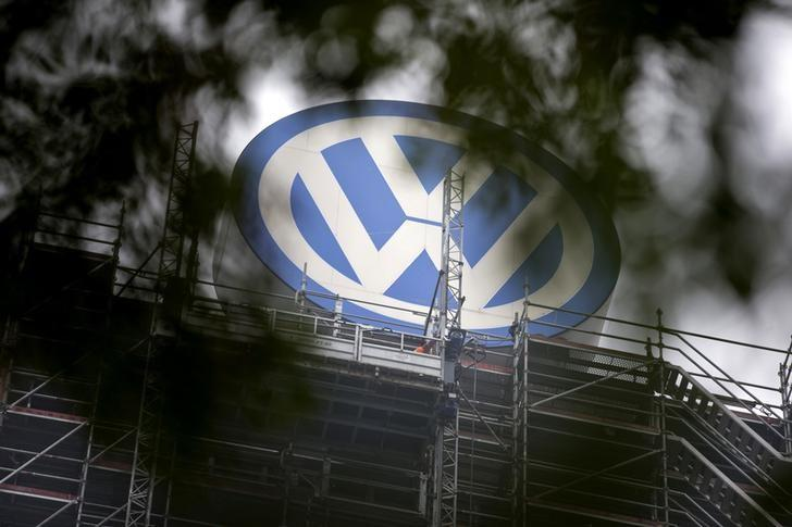 A Volkswagen logo stands on the roof of the company's headquaters in Wolfsburg