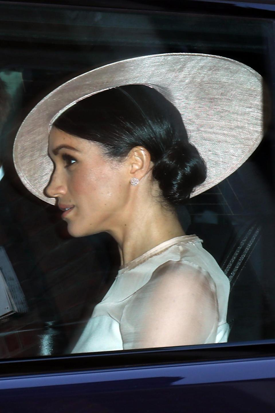The Duchess of Sussex wears a bespoke hat by Philip Treacy. [Photo: Getty]