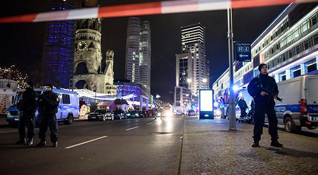 <p>Police officers stand guard at the scene close to the Kaiser Wilhelm memorial church in Berlin. Photo: Clemens Bilan/EPA via AAP</p>