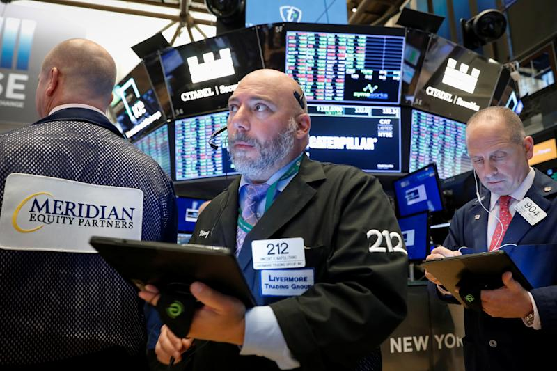 Traders work on the floor at the New York Stock Exchange (NYSE) in New York, U.S., October 21, 2019. REUTERS/Brendan McDermid
