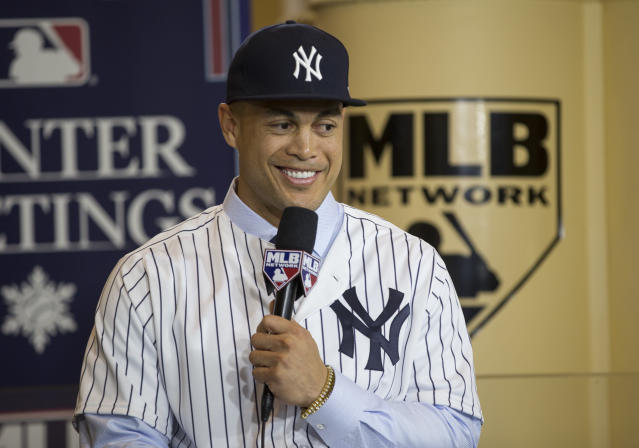 "The Yankees made a splash by acquiring <a class=""link rapid-noclick-resp"" href=""/mlb/players/8634/"" data-ylk=""slk:Giancarlo Stanton"">Giancarlo Stanton</a>, but that doesn't mean they are spending money. (AP)"