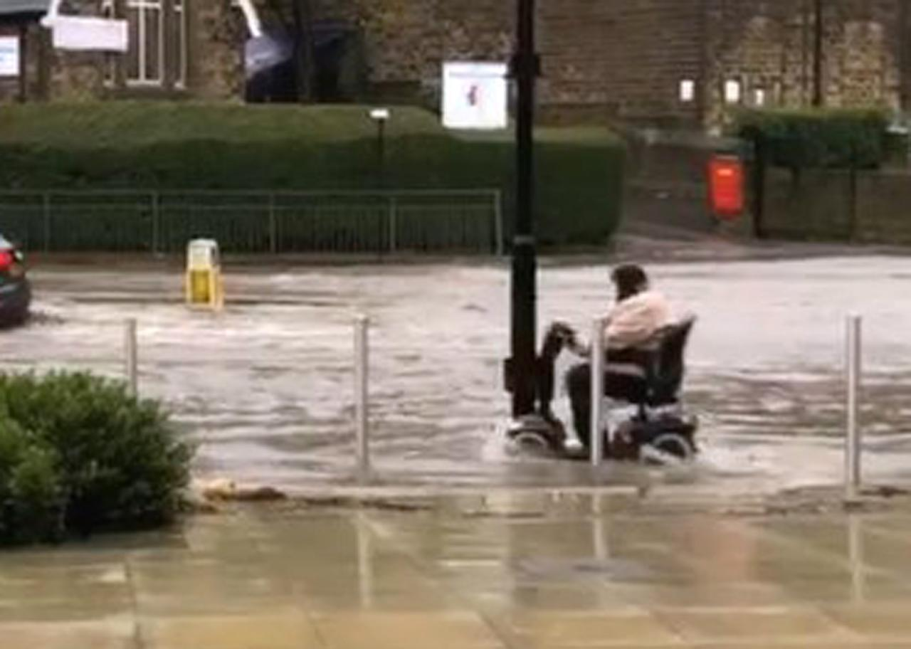 Mobility Scooter in a Flooded Street
