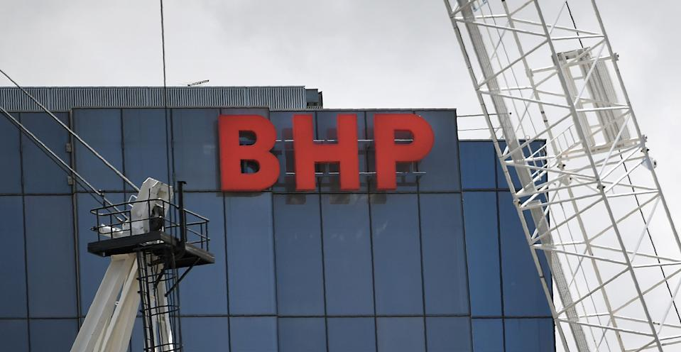 A BHP sign adorns the side of their headquarters in Melbourne on February 19, 2019. - Anglo-Australian mining giant BHP posted an underlying profit of 3.73 billion US dollars on February 19, in a lower-than-expected first-half result after a series of operational problems at its mines. (Photo by William WEST / AFP)        (Photo credit should read WILLIAM WEST/AFP via Getty Images)