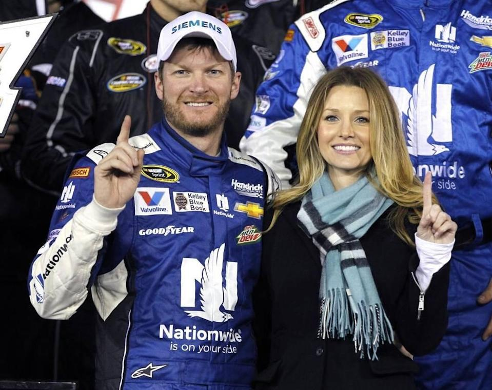 NASCAR icon Dale Earnhardt Jr., seen here in this file photo with his wife, Amy, has expanded his partnership with Charlotte-based Bojangles.
