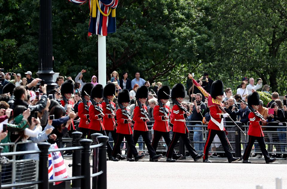 A changing of the guard takes place outside Buckingham Palace, as tourists look on hours before President Trump's ceremonial welcome. (Steve Parsons/PA Images via Getty Images)