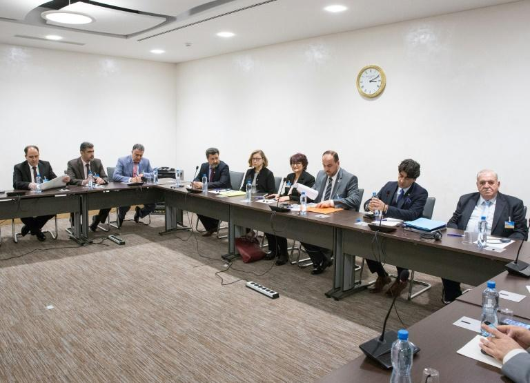 Members of Syria's opposition delegation attend a meeting of Intra-Syria peace talks with the UN Special Envoy for Syria at Palais des Nations in Geneva on March 30, 2017