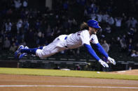 Chicago Cubs' Jake Marisnick (6) dives into third base with a triple against the New York Mets during the eighth inning of a baseball game, Thursday, April, 22, 2021, in Chicago. (AP Photo/David Banks)