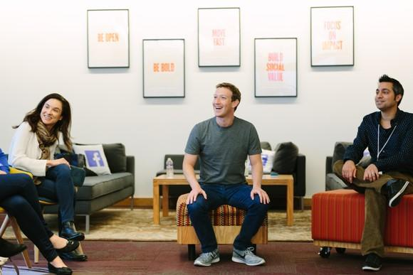 Mark Zuckerberg sitting with guests at Facebook's headquarters.