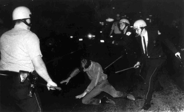 FILE - In this Aug. 27, 1968 file photo, a demonstrator falls to the pavement as he is pursued by Chicago Police officers during the Democratic National Convention in Chicago. Chicago police officers will be facing big challenges when protesters descend on the city for the upcoming summit of NATO leaders May 20-21, 2012. The force boasts of embracing modern techniques and groundbreaking crowd-control strategies but has never completely shaken its reputation for brutality and misconduct. The coming protests also are the big test for Police Superintendent Garry McCarthy, a former ranking commander in the New York City Police Department and protege of NYPD Commissioner William Bratton, who Mayor Rahm Emanuel selected last year to lead Chicago's 12,000-member force. Even before McCarthy's arrival, the Chicago department has been trying to upgrade its tactics and procedures for years. A department that failed to adequately train, equip or even feed officers during the Democratic National Convention of 1968, took pains to make sure the mistakes of the past would not be repeated. (AP Photo, File)