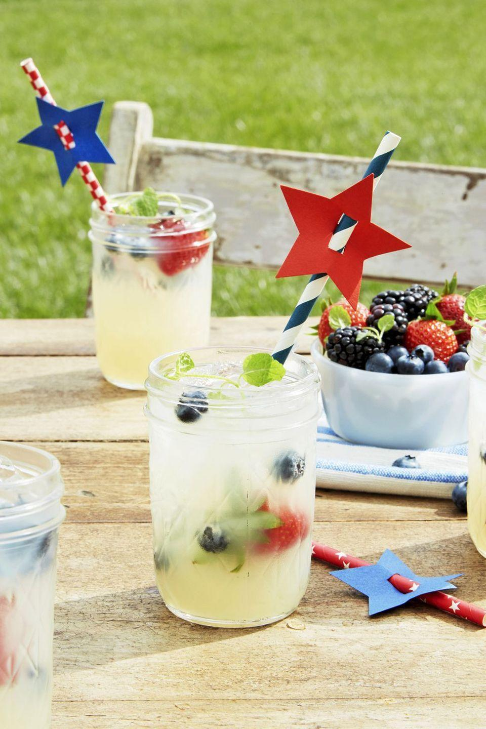 "<p>No al fresco party is complete without a tall glass of lemonade. Here, Mason jars and fresh berries add to the charm. </p><p><strong><a href=""https://www.countryliving.com/food-drinks/a21348860/old-fashioned-lemonade-recipe/"" rel=""nofollow noopener"" target=""_blank"" data-ylk=""slk:Get the recipe"" class=""link rapid-noclick-resp"">Get the recipe</a>.</strong></p><p><a class=""link rapid-noclick-resp"" href=""https://www.amazon.com/Tosnail-Mason-Handle-Plastic-Straws/dp/B07CTGPC7M?tag=syn-yahoo-20&ascsubtag=%5Bartid%7C10050.g.3663%5Bsrc%7Cyahoo-us"" rel=""nofollow noopener"" target=""_blank"" data-ylk=""slk:SHOP MASON JAR MUGS"">SHOP MASON JAR MUGS</a></p>"